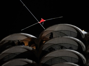 Daredevil Nik Wallenda Walks Across Tightrope In Between Downtown Chicago Buildings