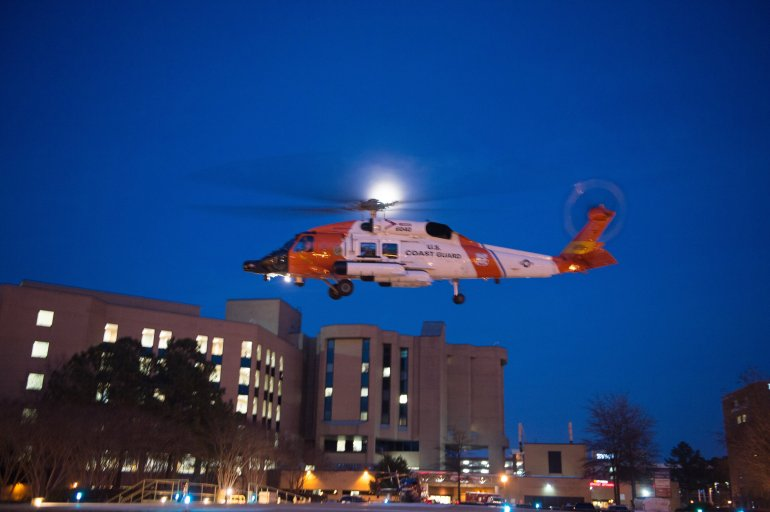 A Coast Guard MH-60 Jayhawk helicopter crew lands at Sentara Norfolk General Hospital in Norfolk, Va., Thursday, April 2, 2015, after medevacing Louis Jordan, 37, who had been missing for more than 60 days. Watchstanders at the Coast Guard 5th District Command Center in Portsmouth received notification from the 1,085-foot German-flagged motor vessel Houston Express at approximately 1:30 p.m. indicating they spotted the man on his vessel approximately 200 miles east of Cape Hatteras, N.C., and took him aboard.