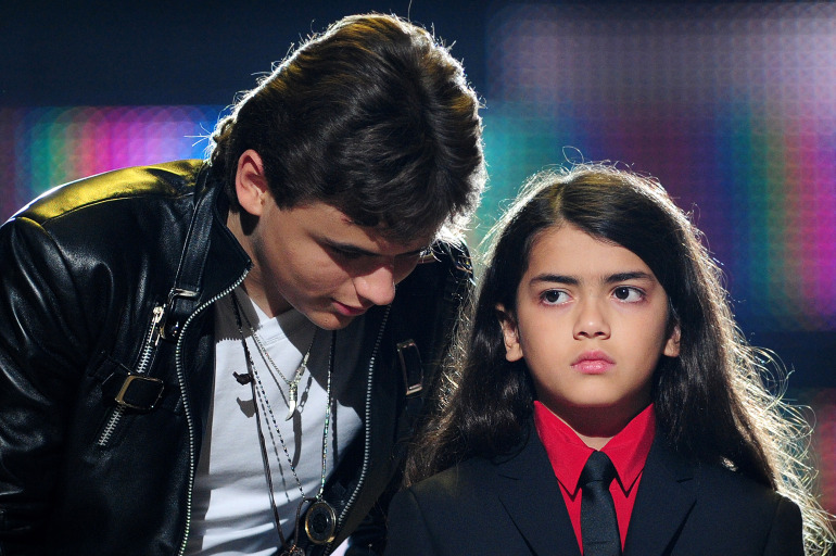 Michael Jackson's children, Prince Jackson (L), and Blanket Jackson (R) speak on stage during the 'Michael Forever' concert in memory of the late Michael Jackson at The Millenium Stadium in Cardiff, Wales on October 8, 2011. AFP PHOTO / LEON NEAL (Photo credit should read LEON NEAL/AFP/Getty Images)
