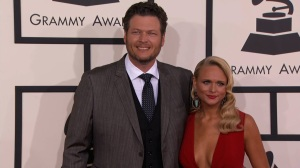 Miranda Lambert and Blake Shelton walk the red carpet at the 56th Annual Grammy Awards.