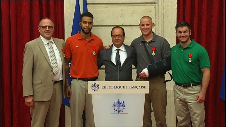 French president Francois Hollande meets with the heroes who thwarted the French train attack on Friday, August 21, 2015. Image taken from a screengrab of a pool feed.