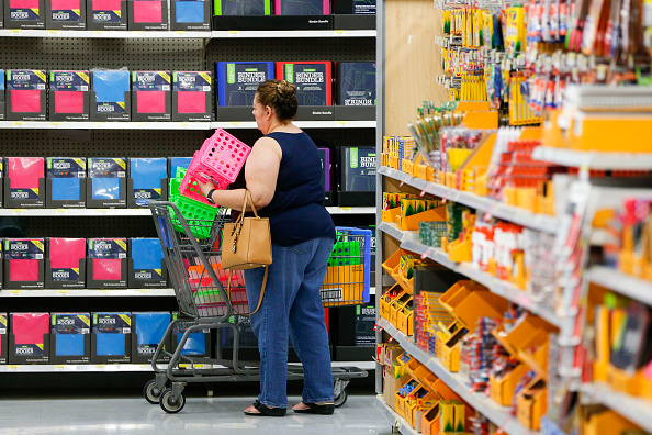 A customer browses school supplies at a Wal-Mart Stores Inc. location in the Porter Ranch neighborhood of Los Angeles, California, U.S., on Thursday, August 6, 2015. More U.S. parents are planning to increase back-to-school spending this fall than at any time in at least the past four years, according to a survey released Tuesday by the International Council of Shopping enters. Photographer: Patrick Fallon/Bloomberg via Getty Images
