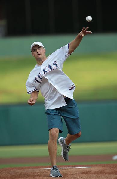 ARLINGTON, TX - AUGUST 18: PGA golfer Jordan Spieth throws the first pitch of the game between the Seattle Mariners and the Texas Rangers at Global Life Park in Arlington on August 18, 2015 in Arlington, Texas. (Photo by Rick Yeatts/Getty Images)