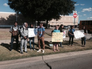 Ahmed's cousins protest outside MacArthur High.