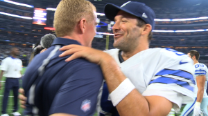 Tony Romo and Jason Garrett embrace after a thrilling 27-26 come from behind victory.