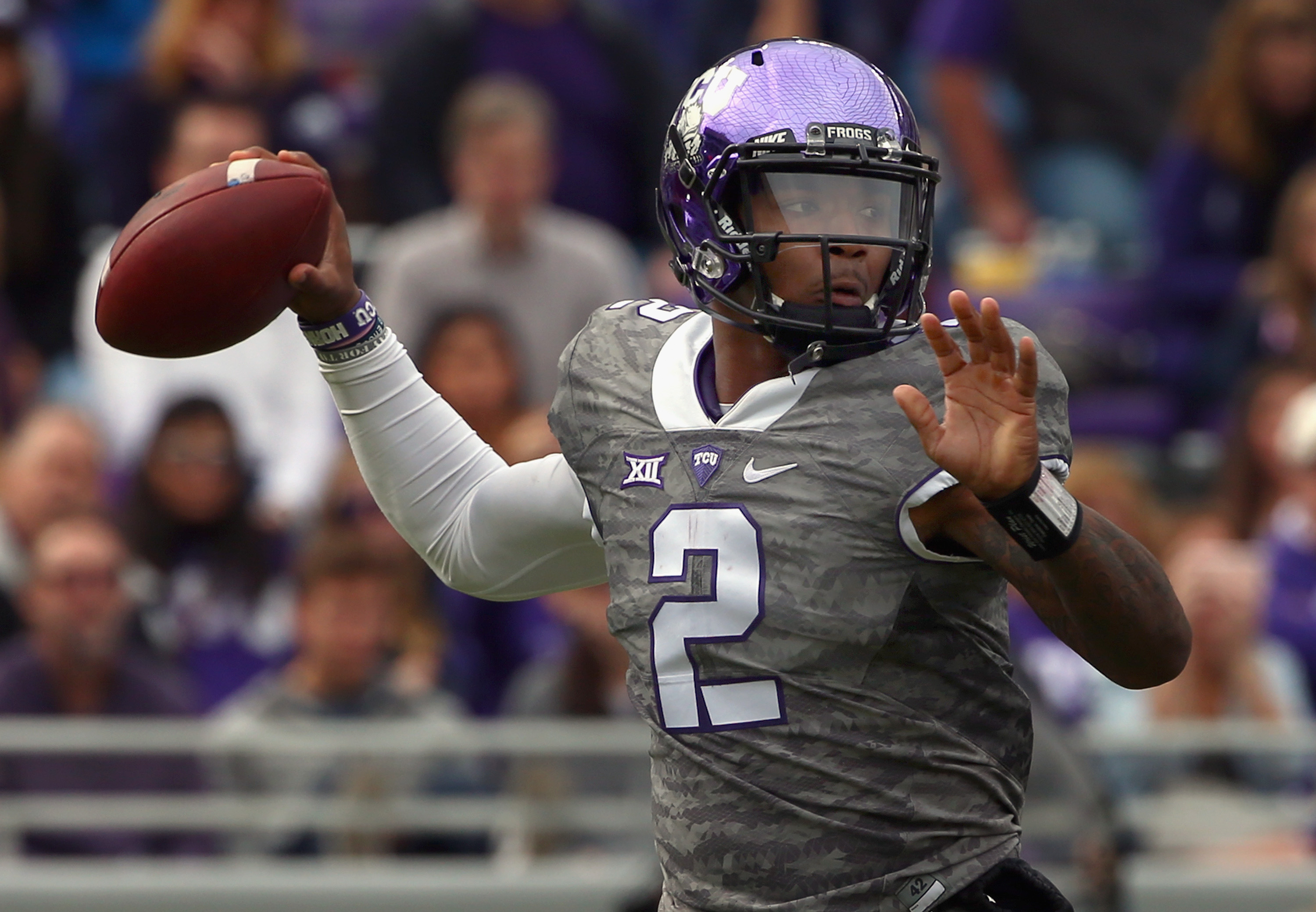 FORT WORTH, TX - NOVEMBER 14:  Trevone Boykin #2 of the TCU Horned Frogs looks for an open receiver against the Kansas Jayhawks in the first quarter at Amon G. Carter Stadium on November 14, 2015 in Fort Worth, Texas.  (Photo by Tom Pennington/Getty Images)