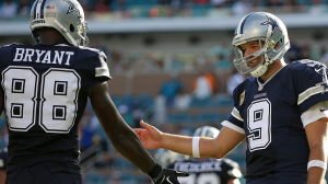 Dez Bryant and Tony Romo high-five after a 4th quarter touchdown. (Photo By: Rob Foldy)