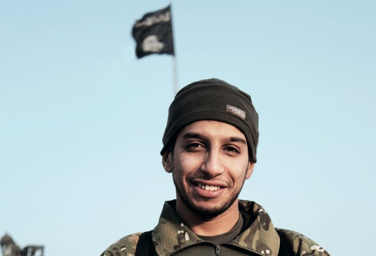 An undated picture taken on November 16, 2015 from the February 2015 issue 7 of the Islamic State (IS) online English-language magazine Dabiq, purportedly shows 27-year-old Belgian IS group leading militant Abdelhamid Abaaoud, also known as Abu Umar al-Baljiki and believed to be the mastermind of a jihadist cell dismantled in Belgium in January 2015, posing at an undisclosed location to illustrate an interview he gave to the magazine, claiming to have rejoined the extremist group in Syria. Flemish-language newspaper De Standaard reported that Brahim Abdeslam, one of the attackers who blew himself up during the Paris attacks last week, had links to Abaaoud, a Belgian of Moroccan descent who allegedly fought with the IS jihadist group in Syria and remains at large.