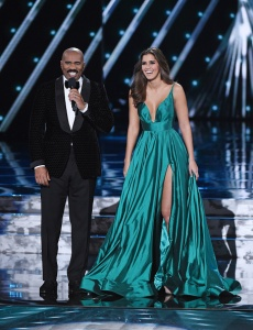 LAS VEGAS, NV - DECEMBER 20:  Host Steve Harvey (L) talks with Miss Universe 2014 Paulina Vega during the 2015 Miss Universe Pageant at The Axis at Planet Hollywood Resort & Casino on December 20, 2015 in Las Vegas, Nevada.  (Photo by Ethan Miller/Getty Images)