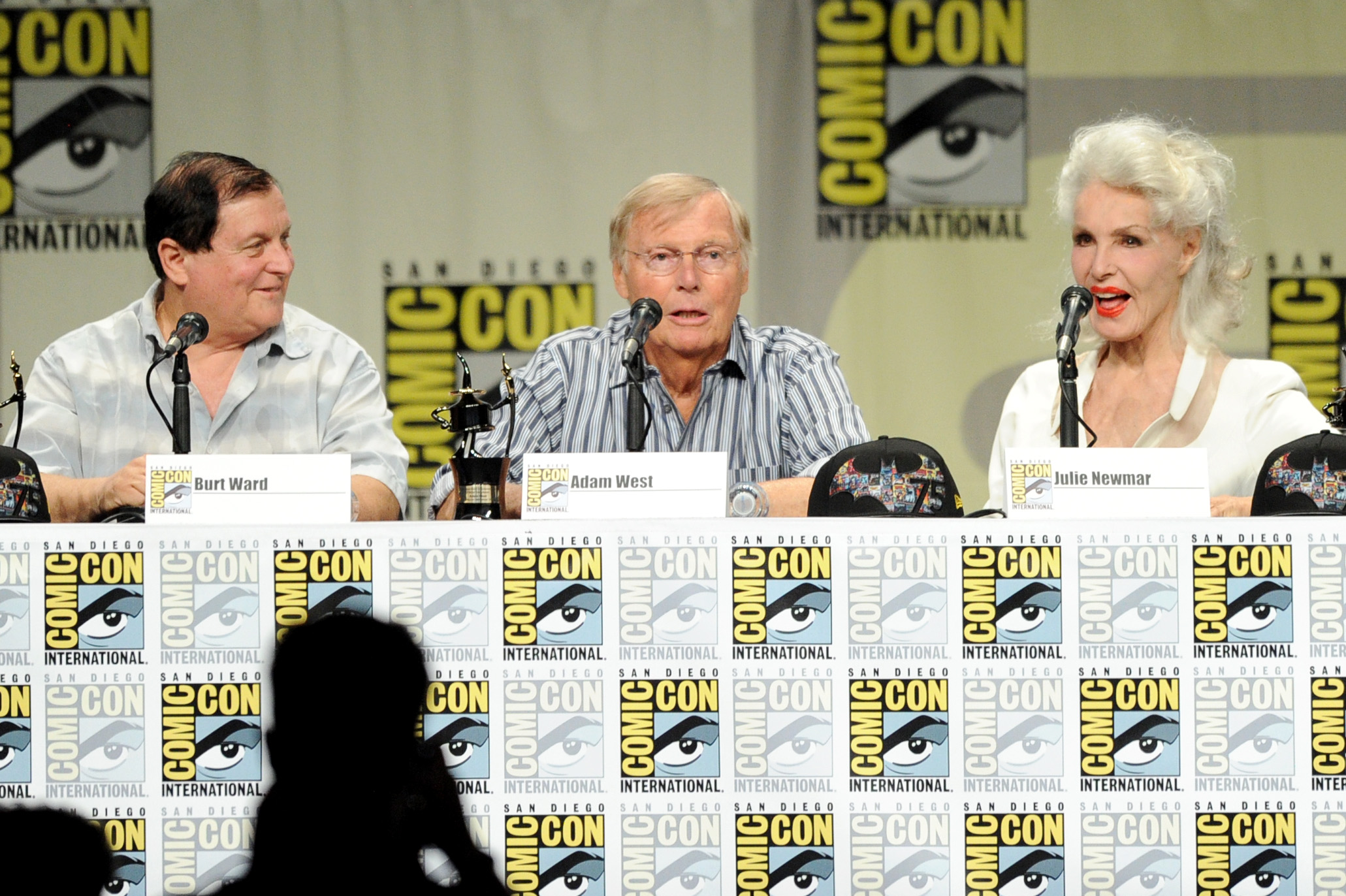 """SAN DIEGO, CA - JULY 24:  (L-R) Actors Burt Ward, Adam West and Julie Newmar attend the """"Batman: The Complete Series"""" DVD release presentation during Comic-Con International 2014 at the San Diego Convention Center on July 24, 2014 in San Diego, California.  (Photo by Kevin Winter/Getty Images)"""