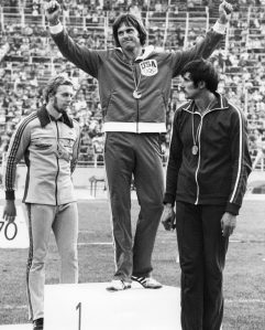 A file picture taken on July 30, 1976 in Montreal, shows USA's Bruce Jenner (C) celebrating his gold medal on the podium after winning the men's decathlon competition, next to West German silver medalist Guido Kratschmer (L) and USSR's bronze medalist Nikolay Avilov. Olympic champion turned reality TV star Bruce Jenner has Americans' rapt attention once again amid talk that he is soon to come out as transgender. People magazine, a trusted conduit for Hollywood publicists, reported at the start of February 2015, that Jenner, 65, would open up in a forthcoming interview with ABC News. AFP PHOTO / EPU (Photo credit should read -/AFP/Getty Images)