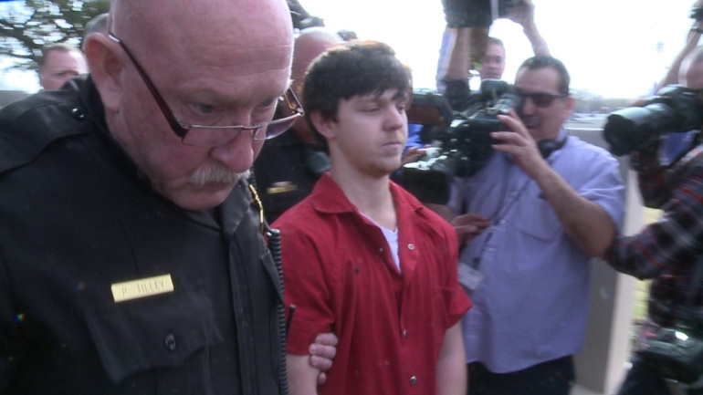 Ethan Couch is led from Tarrant County Juvenile Court after a hearing that moved his case to adult court.