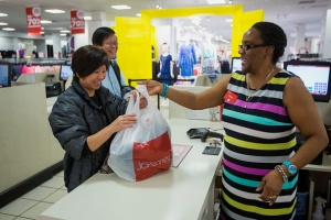 An employee, right, hands a bagged purchase to a customer at a JC Penney Co. store inside the Queens Center Mall in the Queens borough of New York, U.S., on Thursday, Feb. 25, 2016. JC Penney Co. is scheduled to release earnings figures on February 26. Photographer: Michael Nagle/Bloomberg via Getty Images