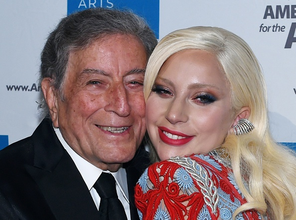 Honoree Lady Gaga poses with Tony Bennett as they arrive for the Americans for the Arts annual gala, the National Arts Awards, October 19, 2015 at Cipriani 42nd St. in New York. Honorees attending include Lady Gaga, Sophia Loren, Herbie Hancock, Alice Walton, Maria Bell and Joan & Irwin Jacobs. AFP PHOTO / TIMOTHY A. CLARY (Photo credit should read TIMOTHY A. CLARY/AFP/Getty Images)