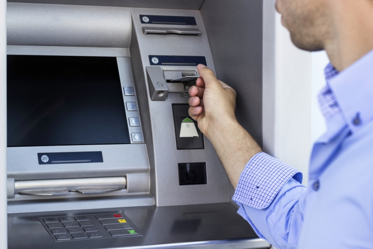 Man using a ATM