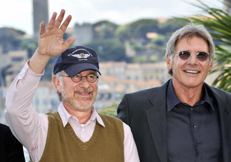 US director Steven Spielberg (L) waves a