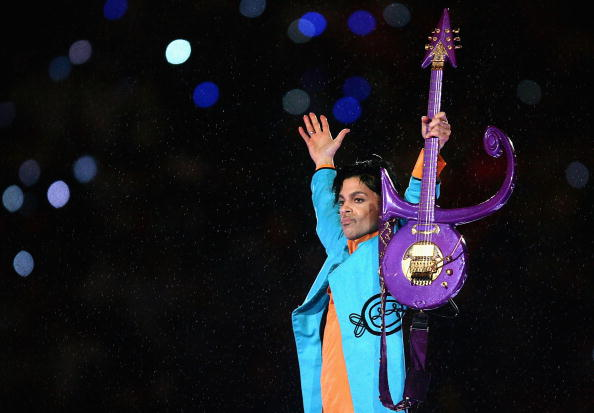 "MIAMI GARDENS, FL - FEBRUARY 04: Prince performs during the ""Pepsi Halftime Show"" at Super Bowl XLI between the Indianapolis Colts and the Chicago Bears on February 4, 2007 at Dolphin Stadium in Miami Gardens, Florida. (Photo by Jonathan Daniel/Getty Images)"