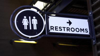 Outdoor Metalic Restroom Sign Close Up