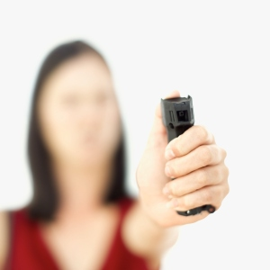 Close-up of a young woman holding a pepper spray (blurred)