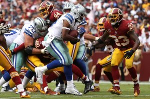 LANDOVER, MD - SEPTEMBER 18: Running back Alfred Morris #46 of the Dallas Cowboys scores a fourth quarter touchdown against free safety DeAngelo Hall #23 of the Washington Redskins at FedExField on September 18, 2016 in Landover, Maryland. (Photo by Patrick Smith/Getty Images)