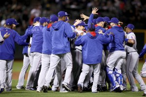 OAKLAND, CA - SEPTEMBER 23: The Texas Rangers celebrate after they clinched the American League West Division Title by beating the Oakland Athletics at Oakland-Alameda County Coliseum on September 23, 2016 in Oakland, California. (Photo by Ezra Shaw/Getty Images)