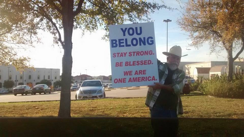 cowboy-holding-sign