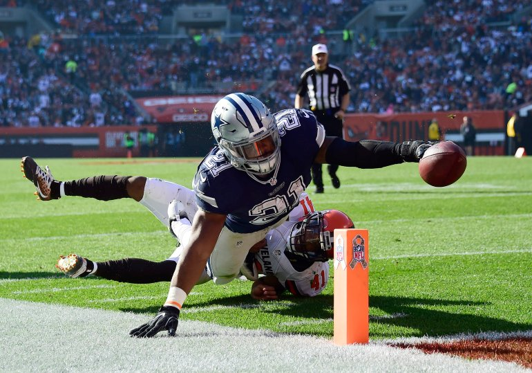 CLEVELAND, OH - NOVEMBER 06: Ezekiel Elliott #21 of the Dallas Cowboys dives for a 10 yard touchdown in the first half against the Cleveland Browns at FirstEnergy Stadium on November 6, 2016 in Cleveland, Ohio. (Photo by Jason Miller/Getty Images)