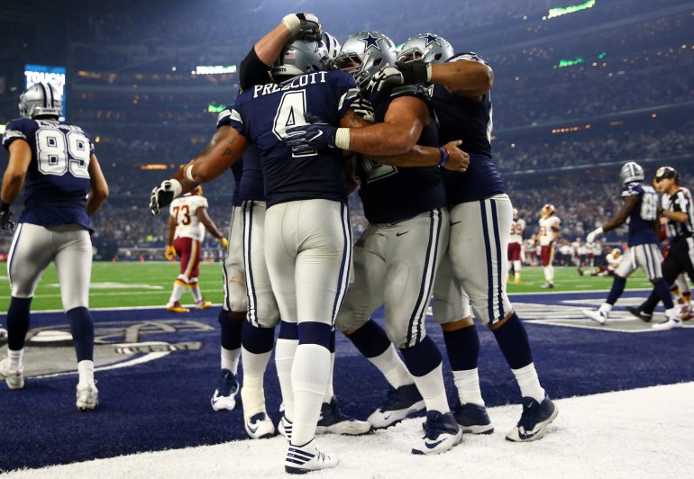 ARLINGTON, TX - NOVEMBER 24: Dak Prescott #4 of the Dallas Cowboys celebrates with teammates after scoring a touchdown during the fourth quarter against the Washington Redskins at AT&T Stadium on November 24, 2016 in Arlington, Texas. (Photo by Tom Pennington/Getty Images)