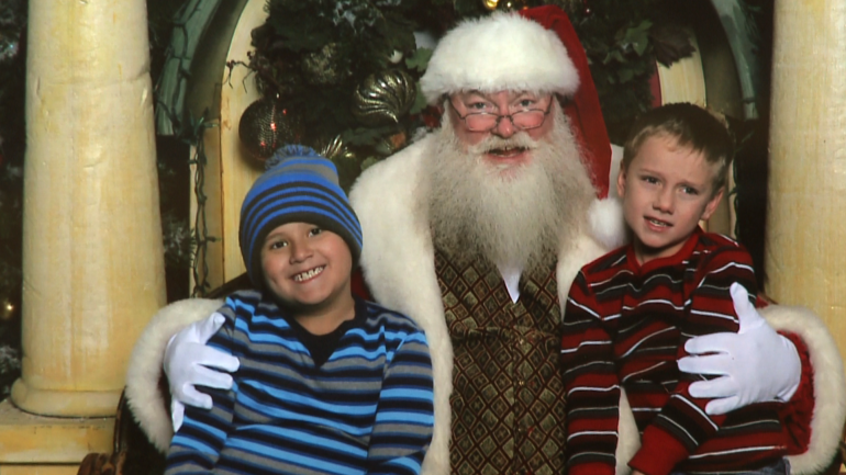 Colin (L) and Cavin (R) Chatham pose with Santa Claus at 2016's Irving Mall Sensitive Santa event.