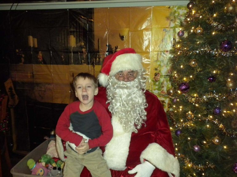 Cavin Chatham takes a picture with a regular mall Santa in 2015 (Pic: Richard Chatham)