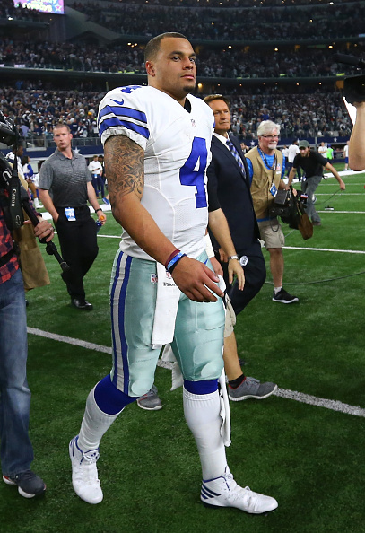 ARLINGTON, TX - JANUARY 15: Dak Prescott #4 of the Dallas Cowboys reacts after losing to the Green Bay Packers in the NFC Divisional Playoff game at AT&T Stadium on January 15, 2017 in Arlington, Texas. (Photo by Ronald Martinez/Getty Images)
