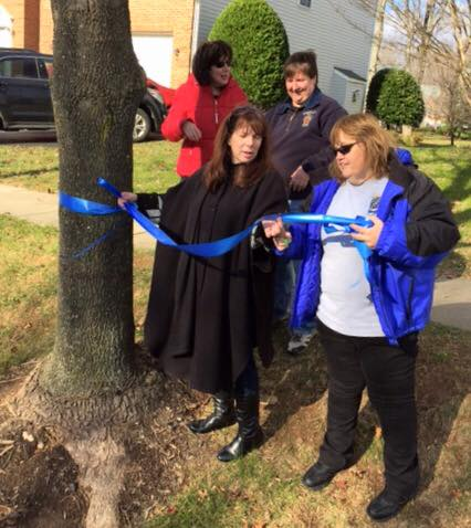 Law enforcement and Officer Leotta's family come together to decorate trees in his memory (PHOTO: MCPD)